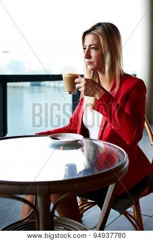 Beautiful elegant woman enjoying cup of coffee outdoors thoughtful executive at lunch break