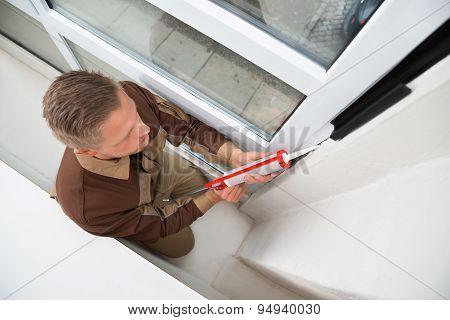 Man Applying Silicone Sealant With Gun