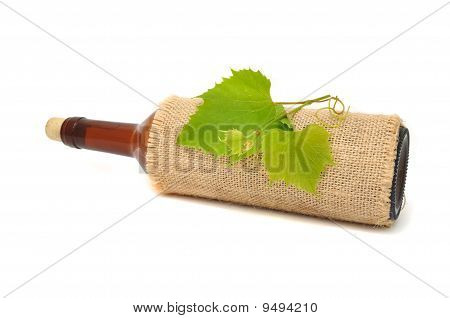 Bottle of Wine in Sackcloth with Grapevine