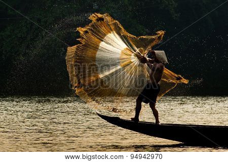 Fishermen are throwing fishing net on river in Hue, Vietnam