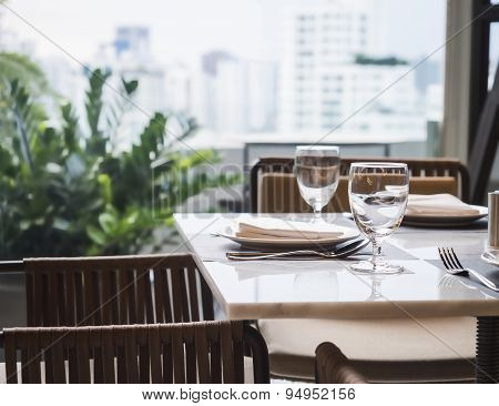Dining Table Set Restaurant Interior With Garden And Skyline View