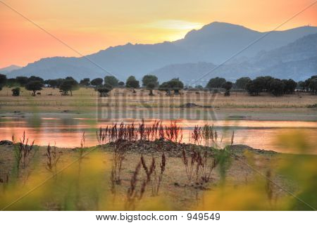 Sunset In Lake And Mountains In Manzanares Europe