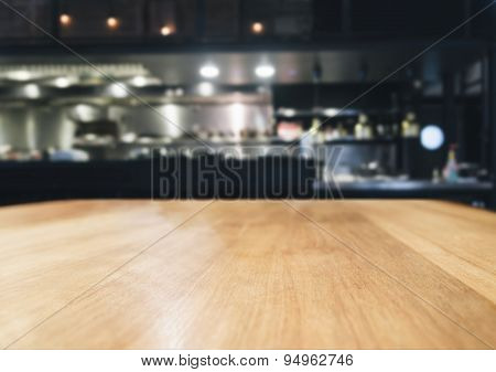 Table top counter with blurred kitchen interior background poster