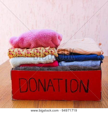 Donation box with clothes. A box of warm clothes.