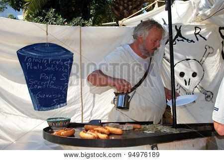 Check cooking sausages on stall, Spain.