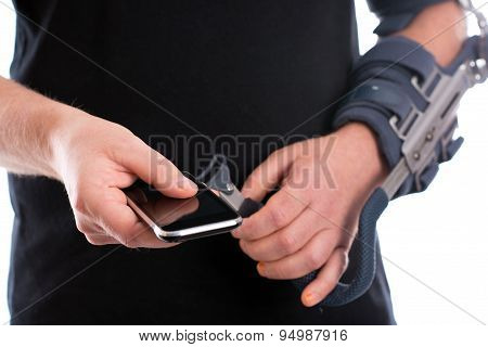 Man With Broken Arm Using Cellphone