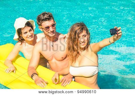 Group Of Best Friends Taking Selfie At The Swimming Pool With Yellow Airbed - Concept Of Friendship