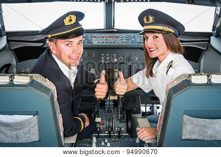 Male And Female Pilots In Flight Simulator