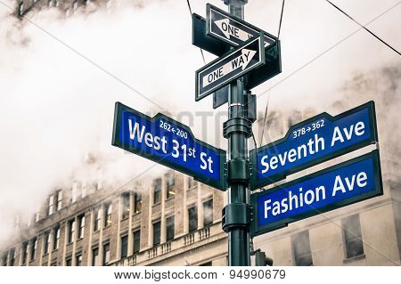Modern Street Sign And Vapor Steam In New York City - Urban Concept And Road Traffic Directions