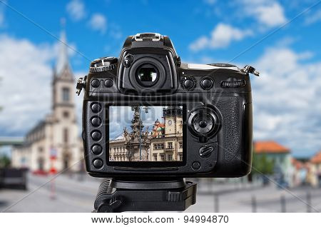 Professional camera on a tripod view at the city