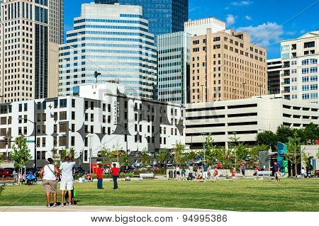 Charlotte, NC. United States. July 4, 2014. People in park in uptown