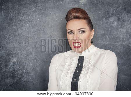 Scared Teacher Woman On The Blackboard Background