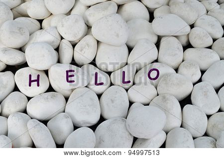 Hello greeting on white marble stones