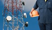 engineer holding orange helmet for workers security on Telecommunications tower background poster