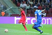 WARSAW POLAND - MAY 27 2015: Carlos Bacca (in Red) of FC Sevilla scores a goal during UEFA Europa League Final game against FC Dnipro at Warsaw National Stadium poster