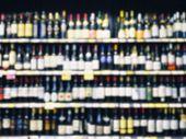 Blurred Wine Liquor Bottle On Shelf wholesale retail shop background poster