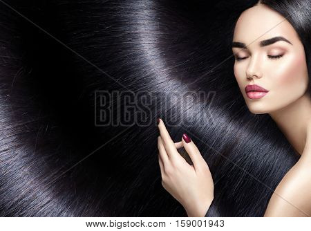 Beautiful long Hair. Beauty woman with luxurious straight red hair as background. Beautiful brunette Model girl touching Healthy Hair. Lady with long smooth shiny straight hair. Hairstyle Cosmetics