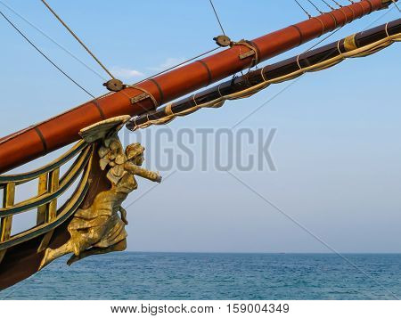 Bowsprit of the ancient sailing ship on the blue sky background
