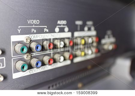 close up back of TV video audio input with sign selective focus