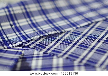 close up texture dark blue and white scott pattern fabric of shirt photo shoot by depth of field for object