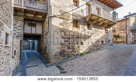 Wide angle view of Puebla de Sanabria street with pergola, Spain