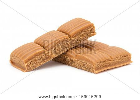 toffee in plate on white background