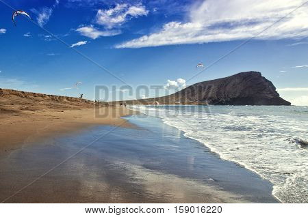 Playa De La Tejita. Kite Surfers On Tenerife Ocean Beach. Tenerife Canary Islands, Spain