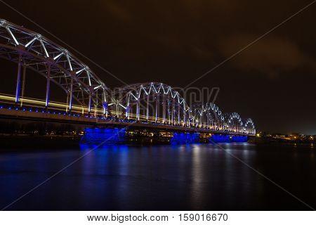 Long time exposure movement of train on the railway bridge.