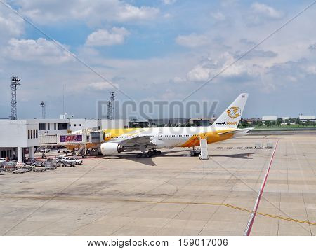 Bangkok, Thailand - June 5, 2016: NokScoot's HS-XBA 'Pround' Boeing 777-200 parked at Don Mueang International Airport. NokScoot is low cost airline in Thailand, joint venture of Nok Air and Scoot.