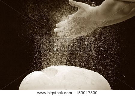 Close-up of hands of the gymnast in talc