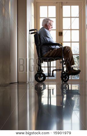 Disabled Senior Man Sitting In Wheelchair