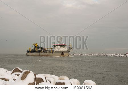Hopper Dredger Vessel entering the port of