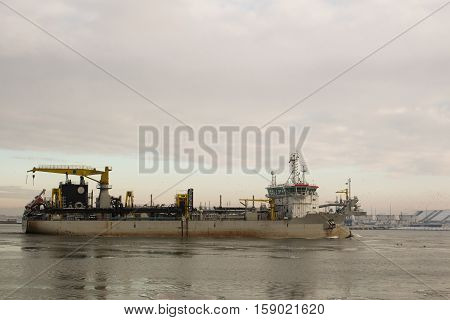 Hopper Dredger Vessel entering the port, ventspils