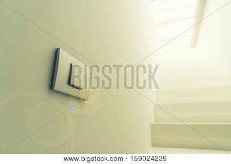 abstract lighting switch on wall with lens fare filter - can use to display or montage on product