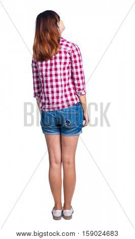 back view of standing young beautiful  woman.  girl  watching. Rear view people collection.  backside view of person.  Girl in shorts and a plaid shirt looking sideways.