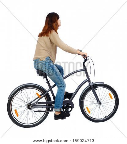 side view of a woman with a bicycle. cyclist sits on the bike. Rear view people collection.  backside view of person. Isolated over white background. The girl in the brown jacket rides a stylish bike.