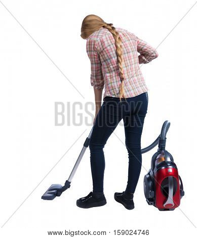 Rear view of a woman with a vacuum cleaner. She is busy cleaning. Rear view people collection.  backside view of person.  Isolated over white background. Cleaner vacuuming.