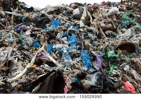 Pile Of Plastic Bags And Other Refined Petroleum Products Dumped In Landfill. Garbage Heap Gives Inf