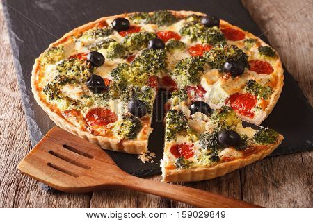 Savory Tart With Chicken, Broccoli, Tomatoes And Olives Close-up. Horizontal