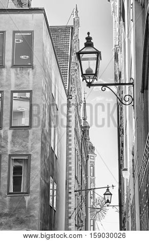 STOCKHOLM, SWEDEN - APRIL 14, 2010: Buildings with lanterns on the walls in Gamla Stan (Old Town). Black and white picture