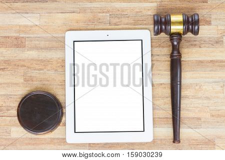 Wooden Law Gavel, tablet with copy space on wooden desktop, top view, law and justice mock up