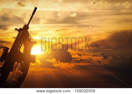 Soldier in combat shooting with his weapon, rifle at sunset. War, army, military. 3D rendering