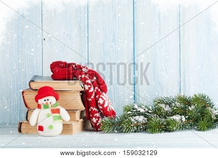 Christmas fir tree, books and snowman toy
