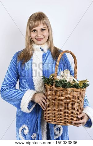 smiling snow maiden holding a basket of toys