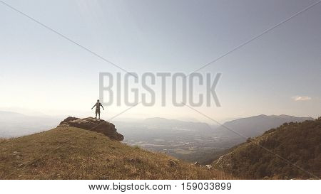 Lone Hiker on admiring the view over Lake Geneva from the French Jura Mountains
