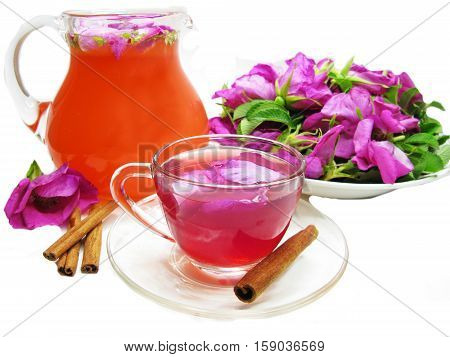 rose punch tea cocktail punch in jug and cup and cinnamon