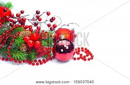 Christmas and New Year red color Decoration isolated on white background. Border art design with holiday baubles. Beautiful Christmas tree closeup decorated with ball, holly berry, tinsel. Copyspace