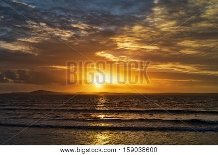 beal beach near ballybunion on the wild atlantic way ireland with an orange sunset