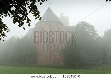Foggy morning around the church in Elburg Gelderland Netherlands