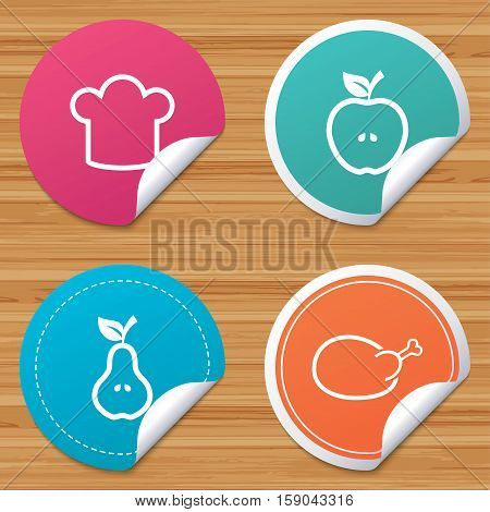 Round stickers or website banners. Food icons. Apple and Pear fruits with leaf symbol. Chicken hen bird meat sign. Chef hat icons. Circle badges with bended corner. Vector